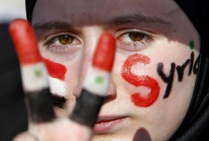A Syrian girl takes part in a protest in Amman