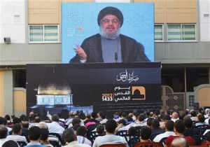 "Lebanon's Hezbollah leader Sayyed Hassan Nasrallah addresses his supporters via a screen, during a rally marking ""Quds (Jerusalem) Day"",in the southern suburbs of Beirut"