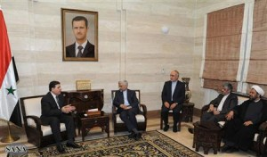 Syria's Prime Minister Wael al-Halqi meets Iran's Supreme National Security Council Secretary Saeed Jalili in Damascus