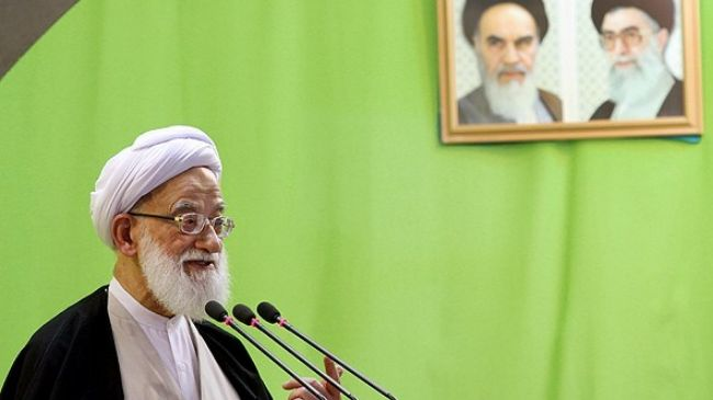 Ayatollah Mohammad Emami Kashani addresses worshippers attending Friday Prayers in Tehran on May 3, 2013.