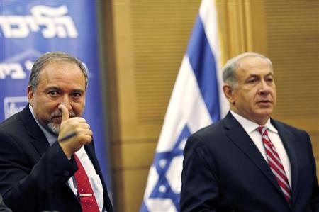 Israel's PM Netanyahu and Lieberman attend a Likud-Beitenu faction meeting at the Knesset in Jerusalem