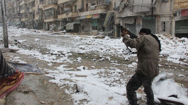 A militant is seen clashing with Syrian government forces in the Salaheddin neighborhood of Syria's Aleppo on December 11, 2013.
