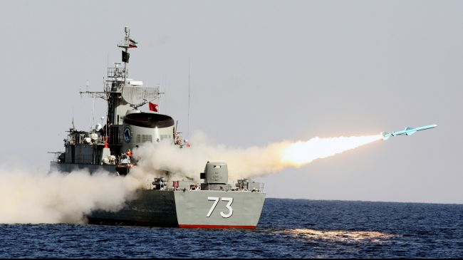 An Iranian vessel launches a missile on the fifth day of the six-day naval drills dubbed Velayat 91 in southern Iran, January 1, 2013.