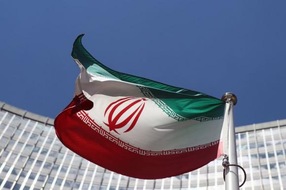 An Iranian flag flutters in front of the United Nations headquarters in Vienna June 17, 2014.