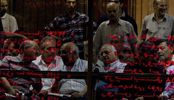 Investors look at an electronic display board reflected in a glass partition at the Tehran Stock Exchange, Sept. 15, 2010. (photo by REUTERS/Caren Firouz)Read more: http://www.al-monitor.com/pulse/originals/2014/06/iran-stock-market-needs-reform.html?utm_source=dlvr.it&utm_medium=twitter##ixzz3554j6Zkd
