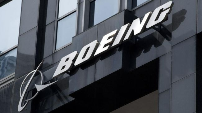 The Boeing logo hangs from the Boeing International Headquarters in Chicago. (file photo)