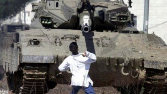 A Palestinian boy throwing a stone at an Israeli tank in the Occupied Territories (file photo).