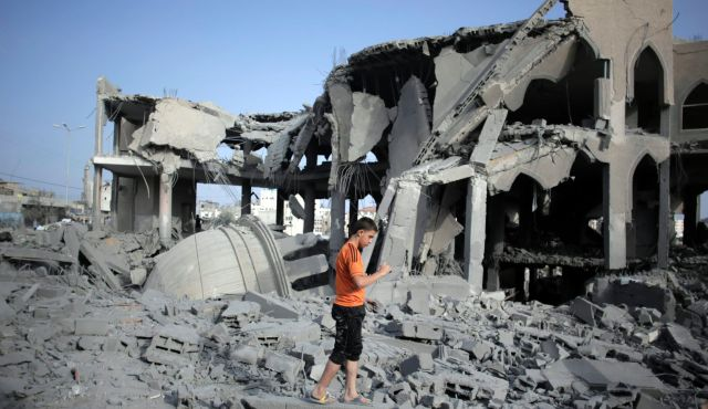 A Palestinian walks amid the rubble of a mosque in Gaza City, following an Israeli airstrike on Monday. Photo by AP