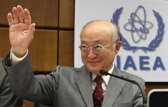 International Atomic Energy Agency (IAEA) Director General Yukiya Amano waves as he arrives for a board of governors meeting at the IAEA headquarters in Vienna June 4, 2014. CREDIT: REUTERS/HEINZ-PETER BADER