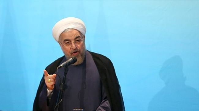 Iran's President Hassan Rouhani addresses a conference on World Mosque Day in Tehran on September 1, 2014.