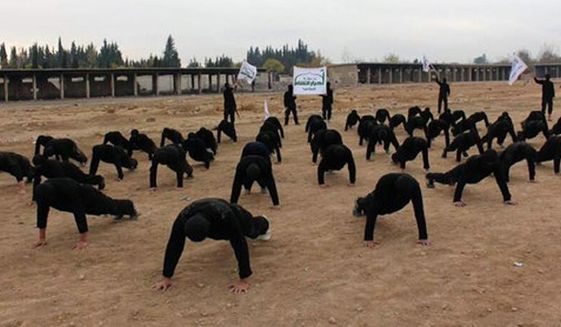 Syria's Ahrar al-Sham members train at a camp in outside Damascus, December, 2013. (Associated Press)