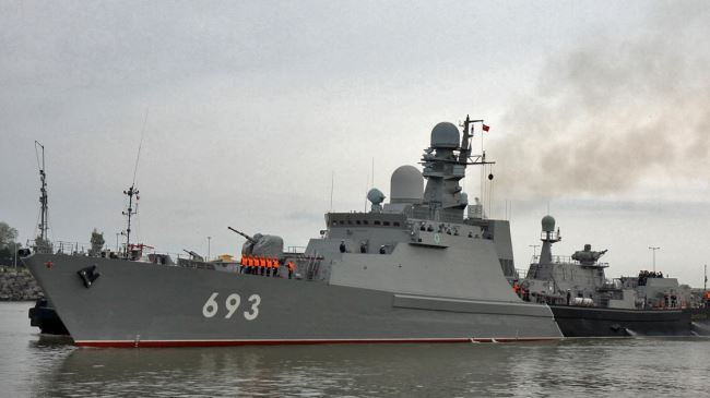 A group of Russia's fleet of warships berths at the Iranian port city of Bandar Anzali on October 13, 2014.