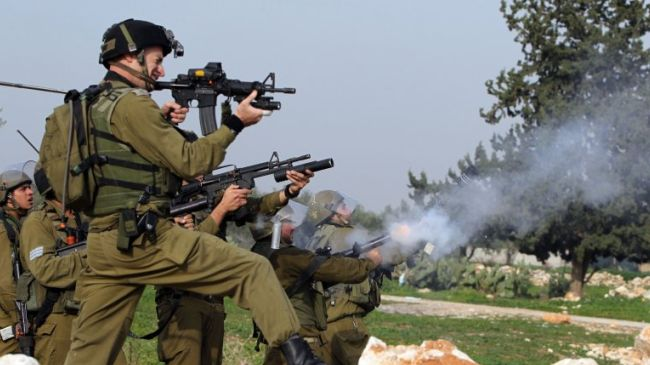 Israeli troops fire tear gas at Palestinian demonstrators in the occupied West Bank. (File photo)