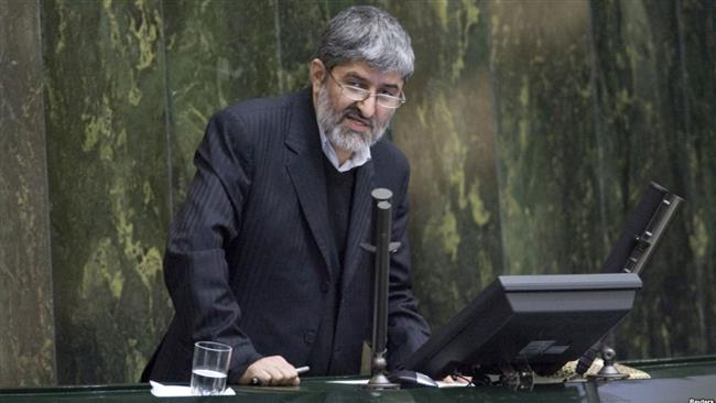 The file photo shows Iranian lawmaker Ali Motahari speaking at a Parliament open session.