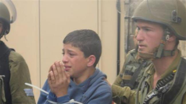 The file photo shows a Palestinian child arrested by the security forces of the Israeli regime.