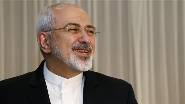 Iranian Foreign Minister Mohammad Javad Zarif jokes with reporters on January 14, 2015 before meeting with the US state secretary in Geneva. (AFP)