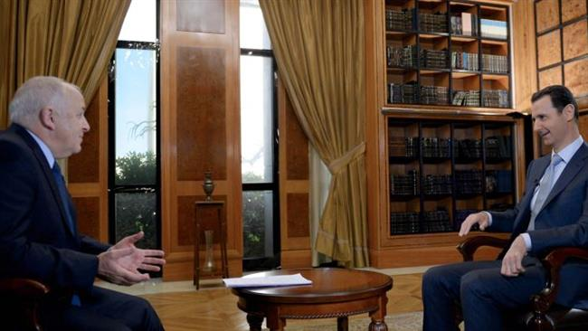 Syrian President Bashar al-Assad (R) giving an interview to the BBC in the capital Damascus on February 8, 2015 which was released by the Syrian Arab News Agency (SANA) on February 10, 2015.