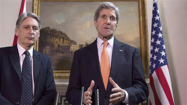 US Secretary of State John Kerry (R) and British Foreign Secretary Philip Hammond address a joint press conference in London on February 21, 2015.
