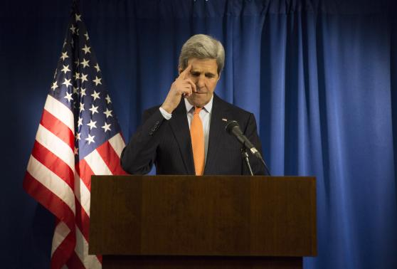 U.S. Secretary of State John Kerry reacts during a media briefing at the U.S. Embassy in London, February 21, 2015.  CREDIT: REUTERS/NEIL HALL (BRITAIN - TAGS: POLITICS)