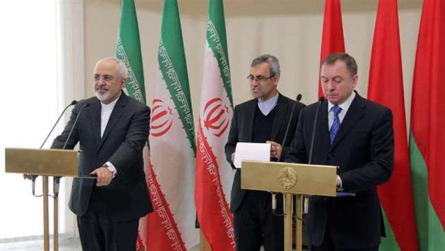 Iran's Foreign Minister Mohammad Javad Zarif (L) and his Belarusian counterpart Vladimir Makei meet in Belarus' capital Minsk on February 17, 2015 before attending a joint press conference.