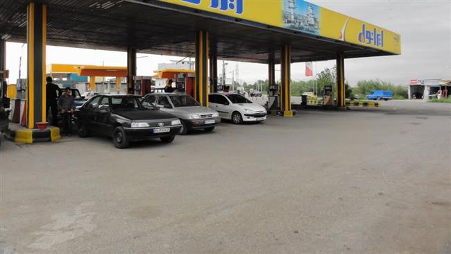 This file photo shows cars gassing up at a petrol station near Tehran.