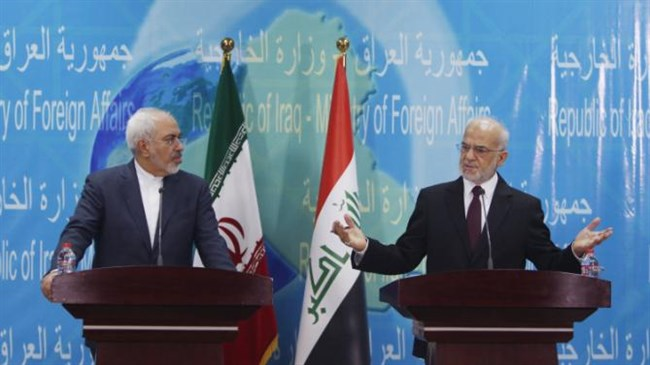 Iranian Foreign Minister Mohammad Javad Zarif (L) during a press conference with Iraqi Foreign Minister Ibrahim al-Jaafari in the Iraqi capital Baghdad on February 24, 2015.