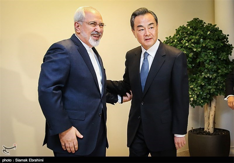 Chinese Foreign Minister Wang Yi meets his Iranian counterpart Zarif in Tehran on February 15, 2015.