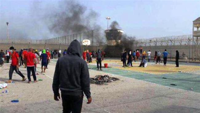 Security forces attacking inmates inside Bahrain's Jaw prison, March 10, 2015.