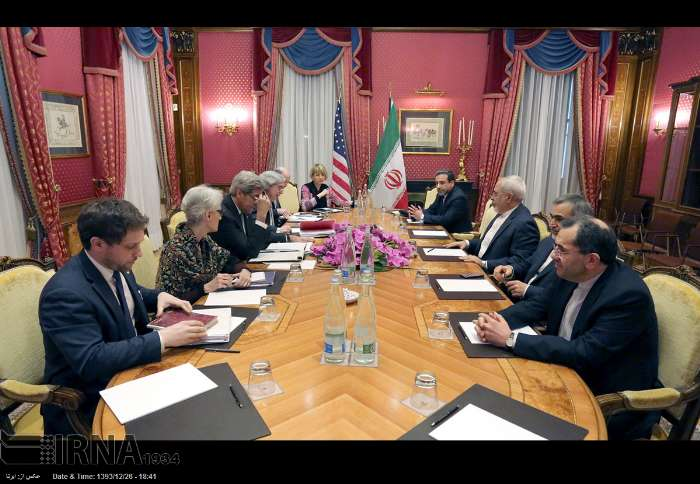 Iranian nuclear negotiators, headed by Foreign Minister Mohammad Javad Zarif, (3rd R) meet the US delegates, headed by Secretary of State John Kerry (3rd L) in the Swiss city of Lusanne, March 17, 2015.