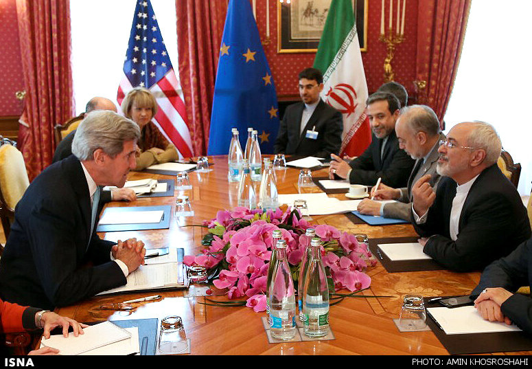 Iranian nuclear negotiators, headed by Foreign Minister Mohammad Javad Zarif, (3rd R) meet the US representatives, headed by Secretary of State John Kerry (3rd L) in the Swiss city of Lusanne, March 18, 2015.