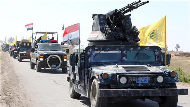 Members of the Iraqi security forces are heading from Samarra city to Tikrit to launch an assault against the ISIL militants on February 28, 2015. ©AFP