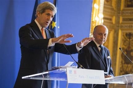 Secretary of State John Kerry, left, speaks to the media during a news conference with French Foreign Minister Laurent Fabius, on Saturday, March 7, 2015, in Paris. Kerry is meeting with the foreign ministers of France, Germany, and Britain to brief them on the status of nuclear negotiations with Iran. (AP Photo/Evan Vucci)