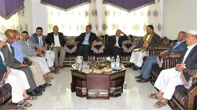 Former Yemeni Prime Minister Khalid Bahah (C-L) sits with ex-Foreign Minister Abdullah Al-Saidi (C-R) and aides at his house in Sana'a on March 16, 2015 after the Ansarullah movement agreed to free him and all his cabinet ministers after nearly two months of house arrest.