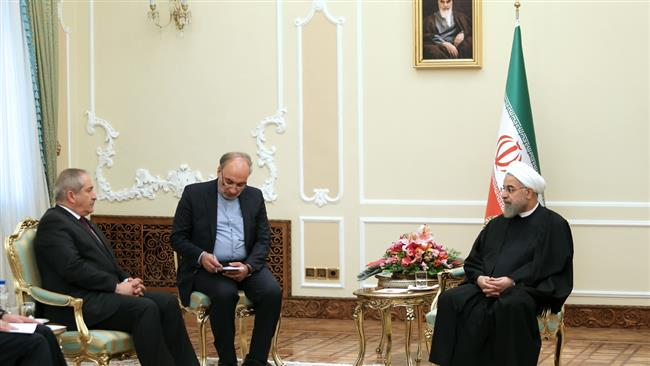 Iranian President Hassan Rouhani (R) meets Jordanian Foreign Minister Nasser Judeh in the Iranian capital, Tehran, on March 7, 2015.