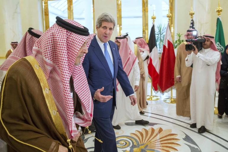 Saudi Arabia warned Thursday that Iran is trying to take over Iraq. U.S. Secretary of State John Kerry walks with Saudi Arabia's Foreign Minister Saud bin Faisal (left) at Riyadh Air Base, March 5, 2015. Reuters/Evan Vucci/Pool