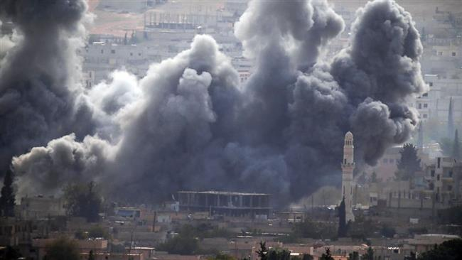 This file photo shows thick smoke rising following an airstrike by the US-led coalition in the town of Kobani in Syria. © AP