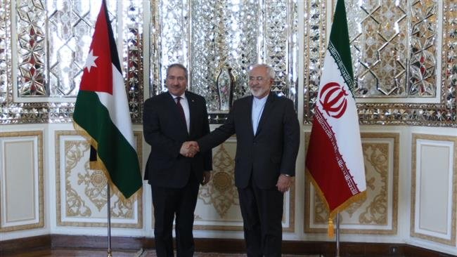 Iranian Foreign Minister Mohammad Javad Zarif (R) shakes hands with his Jordanian counterpart Nasser Judeh in the Iranian capital, Tehran, on March 7, 2015.