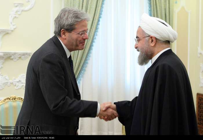 Iran's President Hassan Rouhani and Italy's Foreign Minister Paolo Gentiloni meet in Tehran on March 1, 2015.