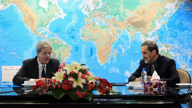 Senior Iranian official Ali Akbar Velayati (R) and Italy's Foreign Minister Paolo Gentiloni meet in Tehran on March 1, 2015.
