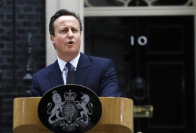 Britain's Prime Minister David Cameron speaks to  the media in 10 Downing Street in London Friday, May 8, 2015.  Cameron's Conservative Party swept to power Friday in Britain's Parliamentary elections winning an unexpected majority. (AP Photo/Kirsty Wigglesworth )
