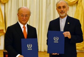 The photo shows IAEA Director General Yukiya Amano (L) and Head of the Atomic Energy Organization of Iran Ali Akbar Salehi after signing a roadmap regarding Iran's nuclear program in Vienna, Austria, on July 14, 2014.