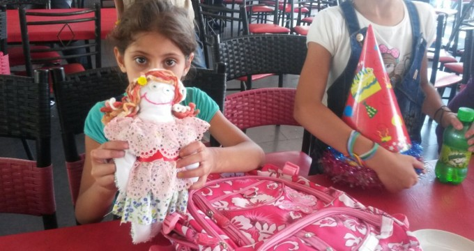 Iran donates doll to Syrian war-torn children