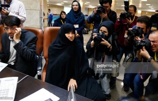 Iranian Esmat Savadi (2nd L) registers her candidacy for the Assembly of Experts elections