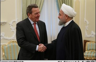 Iran's President Rouhani meets ex-German chancellor in Tehran