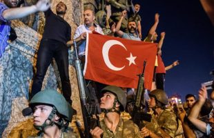 Turkish soldiers stay with weapons at Taksim Square as people protest against a military coup attempt in Istanbul on July 16, 2016. (AFP)