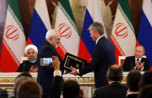 Iran, Russia ink deals as Rouhani visits Moscow